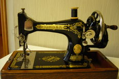 Singer sewing machine 28K with a wooden cover, 1937