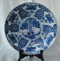 18th century Delft earthenware dish with flower decor