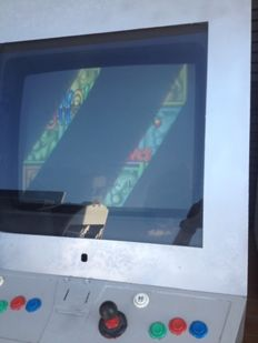 "Arcade cabinet with game ""Snow bros 2"""