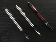 Elysee fountain pens and rollerball pen. Steel fountain pens and red marbled rollerball pen. Has never been used.
