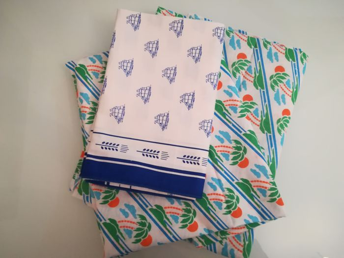 Lot of two identical tablecloths and one rectangular tablecloth with sailing ships, in printed cotton