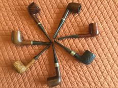 A dozen pipes including 5 of the brand Chacom and 7 of Butz Choquin.