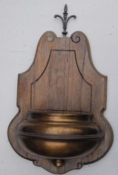Large holy water font of wood and copper (glass/metal interior is missing)