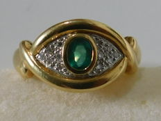 18 kt gold Osiris eye ring with central emerald and pavé of brilliants