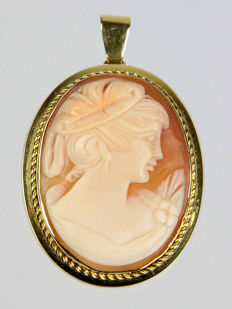 Antique gold pendant with hand-carved shell cameo