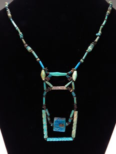 Egyptian necklace of decorated faience beads and a Horus eye (Wedjat) tablet - 54 cm