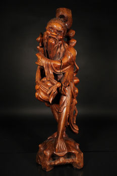 Large hardwood sculpture of an Immortal (67 cm) - China - early 20th century