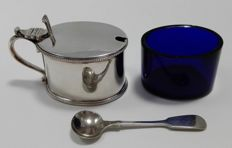 A silver plated mustard pot with glass insert and spoon