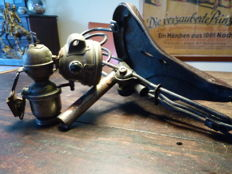 Carbide bike lamp and antique leather bike and motorcycle saddle - museum pieces