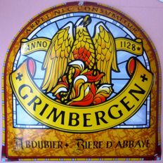 An enamel sign of the Abbey beer GRIMBERGEN
