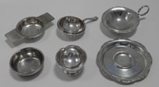 Three silver plated tea strainers