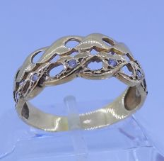 Cocktail ring of 18 kt yellow gold - zirconias Interior measurement 18.5 mm.