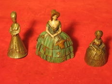 Small table bells made of bronze and brass, female figures in historical costume of middle ages, 18th century and Victorian era