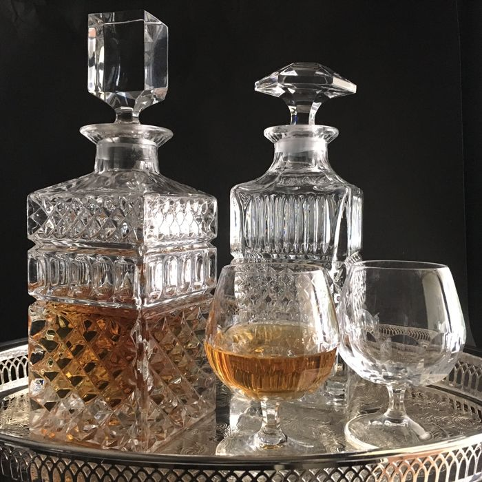 Two vintage whiskey decanters, cognac decanter, bar set with two cognac glasses, mid century bar ware