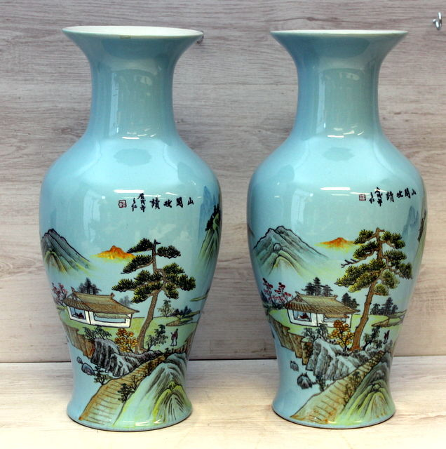 A pair of blue porcelain vases with landscape scenes - China - late 20th century