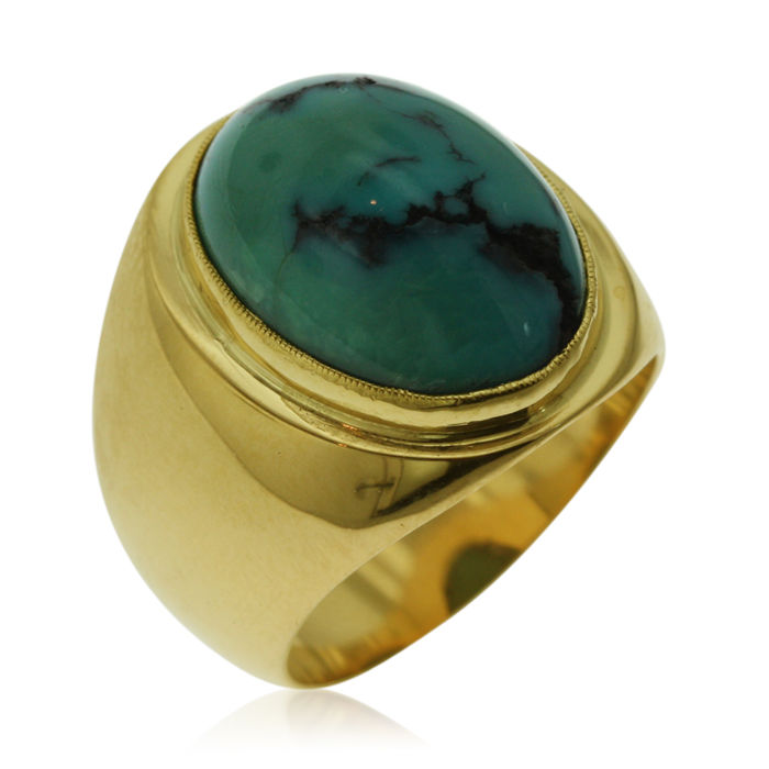 Wide 18 kt Gold ring with a cabochon cut Turquoise