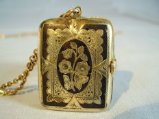 Victorian photo medallion in gold foil with black enamel on a long chain