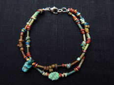 Egyptian double bracelet of faience beads, Ptaikos and decorated amulet - 18.5 cm