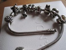 Pandora - bracelet with 8 Pandora charms made of Sterling silver, some with zirconia, L 20 cm