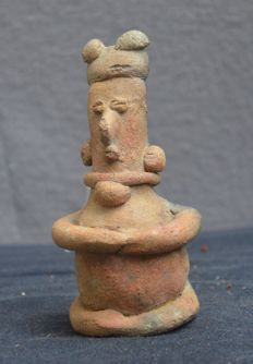 Pre-Colombian earthenware sculpture/rattle depicting a seated figure