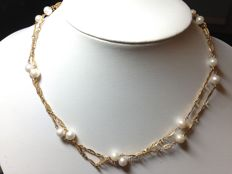 Yellow gold necklace (18 kt) with pearls