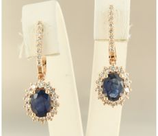 ***** NO RESERVE PRICE ***** 14k rose gold earrings set with sapphire and 44 brilliant cut diamonds, approximately 2.60 carats in total.