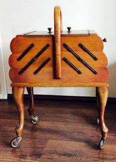 Large piece of sewing furniture on wheels, first half 20th century
