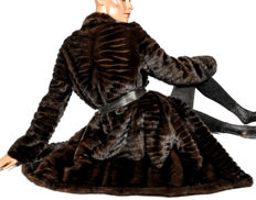 Light modern fur coat made of coffee-brown mink fur with leather striped soft