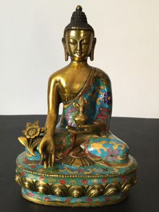 Representation of the Medicine Buddha in patinated copper and cloisonné gold, Nepal, early 21st century.