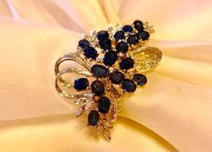 White gold brooch with antique cut Sapphires and Diamonds