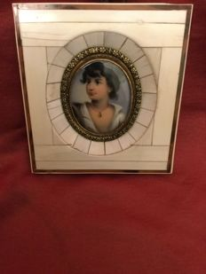 Miniature portrait, oil on porcelain with ivory and tortoiseshell frame, France, early 20th century