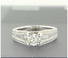 18 kt white gold ring set with brilliant and baguette cut diamonds, approx. 2.52 carat in total, ring size 17 (53)