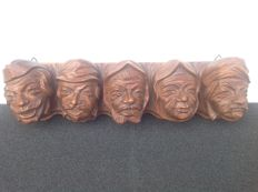 Antique wooden pipe rack with 5 heads.