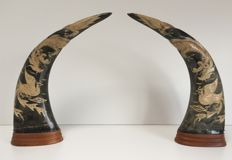 Pair of tooled buffalo horns - the dragon and bird - Asian carving on base