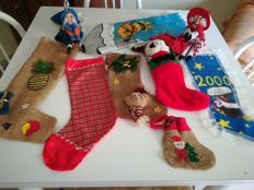 Lot of different Christmas stockings and two Witches