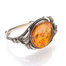 Bangle made of 925 silver, blackened and with preseed amber circa 1950