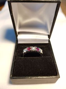 14 karat white gold ring set with three diamonds and two rubies