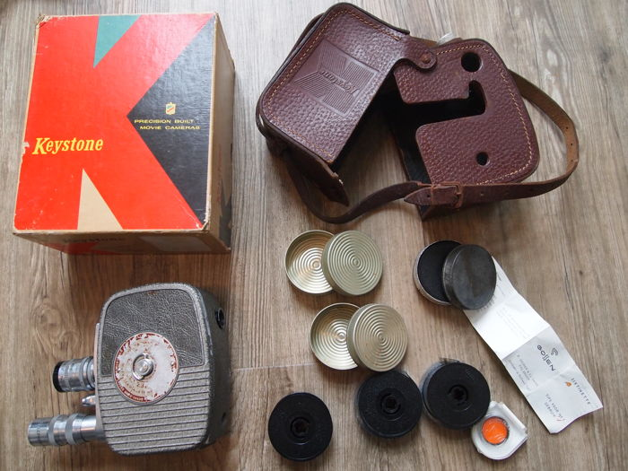 Keystone 8mm camera with leather wrap  original box and film spools
