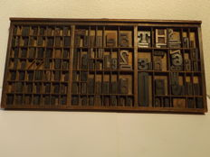 Industrial typecase tray with original wooden printing letters, numbers and some punctuation marks, Ca. 1930, the Netherlands