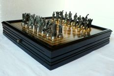 Chess made in fine pewter with gold and silver finishes. Marquetry board.