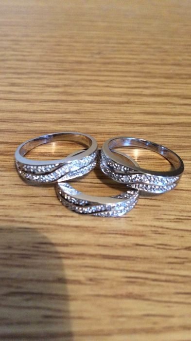 Three white gold 18ct rings, 8.3 grams, size 53, 54, 55 with small (42) diamonds 1 to 2 points all hallmarked