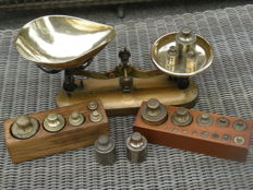 Cast iron copper-coloured scales with two sets of copper weights in wooden blocks and five separate weights, second half of the 20th century