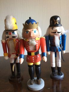 Three large old wooden nutcrackers