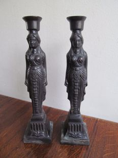 Pair of bronze candlesticks with female figures or caryatids - France - first half of the 20th century