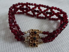 Bracelet with 3 strands of glass garnet and 14 kt gold clasp with 3 small glass garnets and separate strand