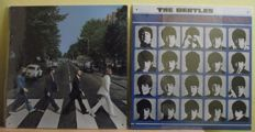 Two very cool, Beatles 'A Hard Days Night' and 'Abbey Road'( embossed )LP cover, tin signs. 12 inches by 12 inches( same size as the actual LP cover.s.