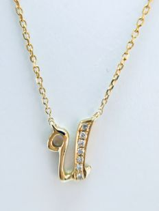 "18 kt yellow gold initial necklace with diamond set letter ""U"" - 0.02 ct G/SI - length 40 cm"