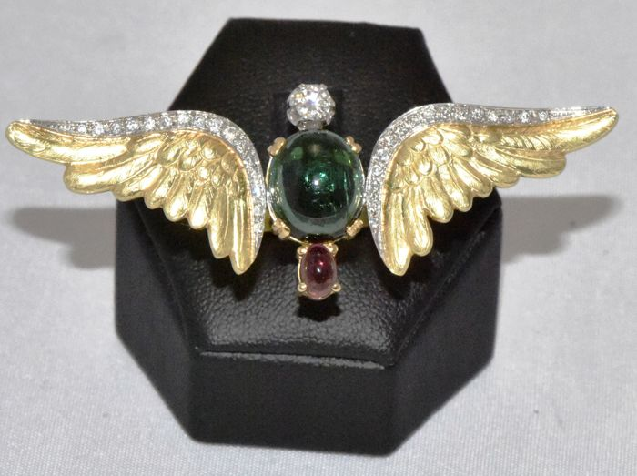 Freedom ring in 18 kt white and yellow gold with tourmaline and 0.52 ct of diamonds