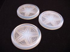 Three opalescent glass bottle coasters, Art Deco