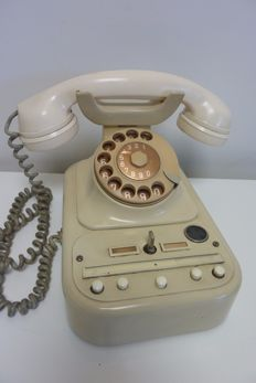 Stylish old office desk telephone Siemens with bakelite horn, ivory colour